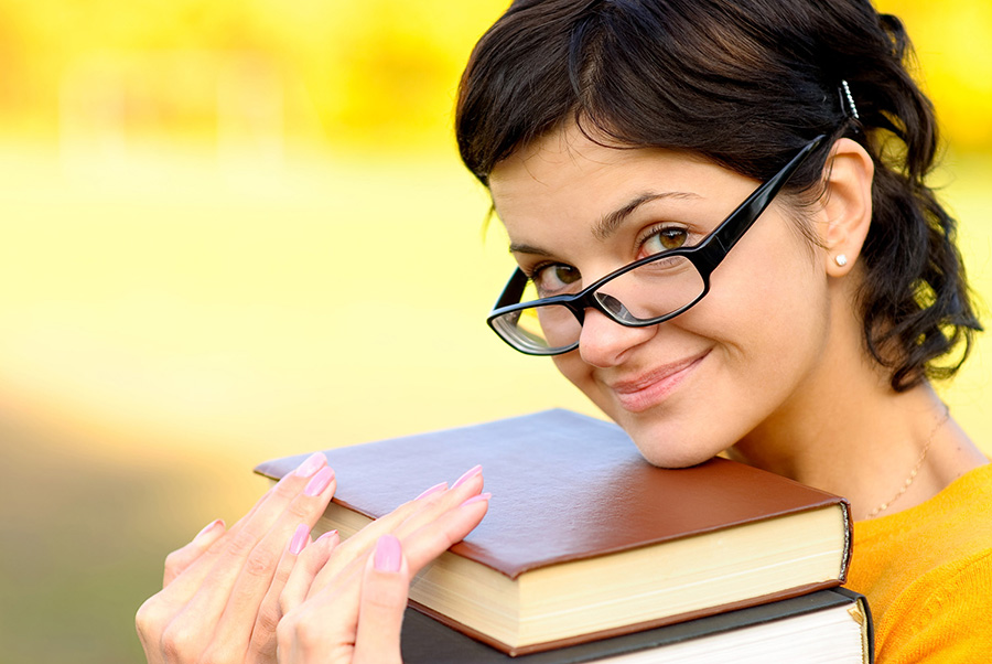 Portrait of girl with books
